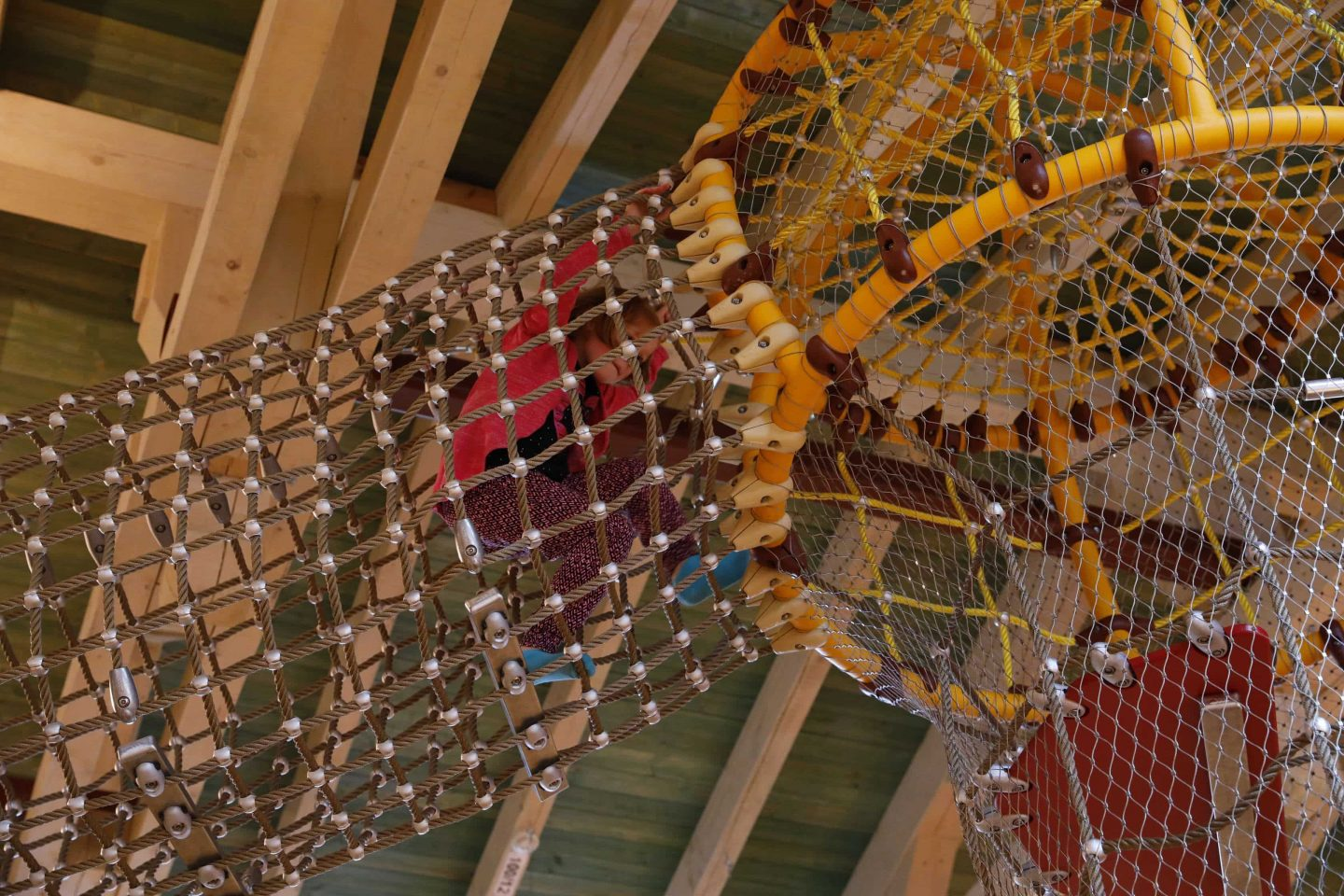Safety nets are stretched around the custom-made play equipment